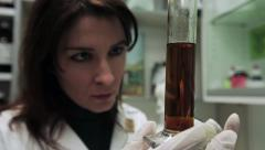 Beautiful Pharmacy checking a liquid. About medicine, chemistry and science. Stock Footage