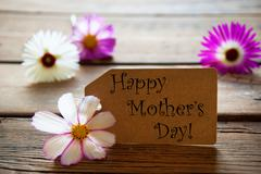 Label With Text Happy Mothers Day With Cosmea Blossoms - stock photo