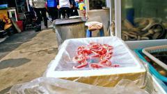 Peeling alive eel fish struggling in Busan Jagalchi Fish Market, South Korea Stock Footage