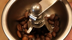 Grinding coffee in a manual coffee mill Stock Footage