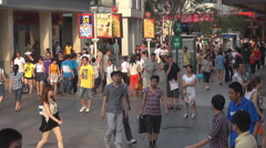 Busy commercial road Shenzhen downtown pedestrian person crowded day icon emblem Stock Footage
