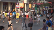 Stock Video Footage of Busy commercial road Shenzhen downtown pedestrian person crowded day icon emblem