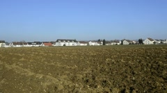 Field close between a housing area Stock Footage