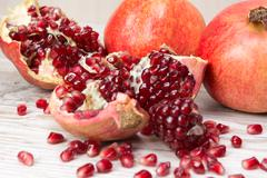 pomegranate fruits and grains - stock photo