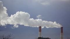 From industrial chimneys belching smoke Stock Footage