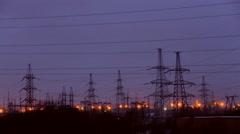 High-voltage transmission line night Stock Footage