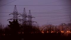 high-voltage transmission line city - stock footage