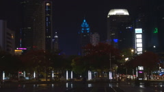 Financial district crowded downtown Shenzhen cityscape traffic building night  - stock footage