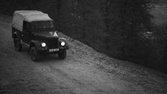Old military jeep down hill 1 - stock footage