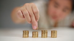 Girl stacking coins Stock Footage