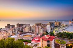 Malaga, Spain dawn skyline towards the Mediterranean Sea. Stock Photos