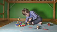 Boy building with Lego Stock Footage