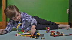Boy playing with Lego Stock Footage