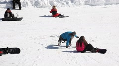 A lady is trying to do snowboard at Kartepe in Izmit 2 Stock Footage