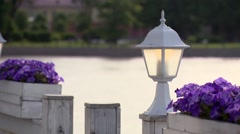 Exterior. Floating pier with lantern and flowers petunias. Stock Footage