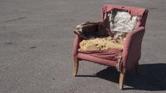Retro Ragged Armchair Outside On Asphalt Stock Footage