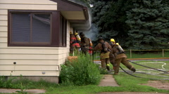 Firefighers Enter House Stock Footage