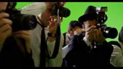 4K Group of paparazzi. Photo shooting on green screen. Slow motion. Arkistovideo