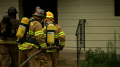 Firefighers Enter House 2 - stock footage