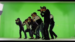 4K Group of paparazzi. Photo shooting on green screen. Slow motion. - stock footage