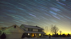 Stock Video Footage of Stars with trails shoot across winter night sky, seamless loop.