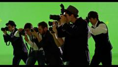 4K Group of paparazzi. Photo shooting on green screen. Slow motion. Stock Footage