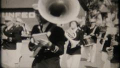 Marching band in local, small town, parade - 11 - vintage film home movie Stock Footage