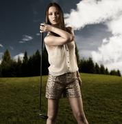 Beautiful woman with golfclub in the right hand Stock Photos