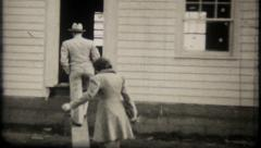21 - home owners inspect new home construction - vintage film home movie Stock Footage