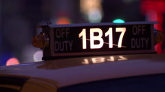 NY-taxi drives away night long lens Stock Footage