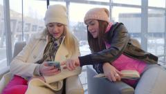 Teens Study In A Library,Girl Uses Her Friend's Smartphone To Look Something Up Stock Footage