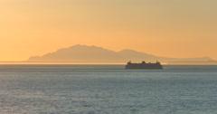 4K Ferry at Dusk Sun Setting Over Ocean Orange Silhouette Stock Footage