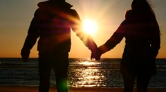 man and woman slow motion towards to sun and sea side. - stock footage