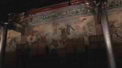 Forward dolly shot of art wall at Dalongdong Baoan Temple Stock Footage
