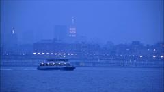 Stock Video Footage of NY-Manhattan skyline HudsonRiver dusk fog water taxi pan