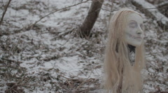 Frozen Severed Head in Falling Snow | 1080p Film Look Stock Footage