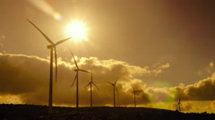 4K wind mill turbines site on mountain timelapse with cloudy sky Stock Footage