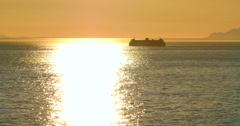 4K Passenger Ferry Boat Silhouette in Front of Setting Sun Stock Footage