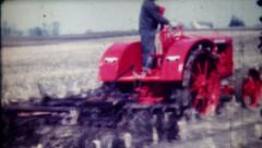 89 - farmer plows field with tractor for spring planting-vintage film home movie Stock Footage