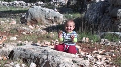 Child plays on the ground in Lycian forest zoom in Stock Footage