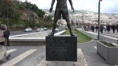 4k People looking CR7 statue in Funchal city harbor Madeira Stock Footage
