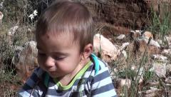 Small boy sits on the ground in Lycian forest zoom out Stock Footage