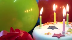 Cake candles red and green balloons - stock footage