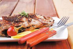main course on wood - stock photo