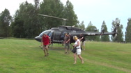 Stock Video Footage of Undenas, helicopter flight, tourists ready for take off