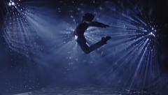 Dancer dancing and jumping on beautiful real background. Slow Motion. Stock Footage