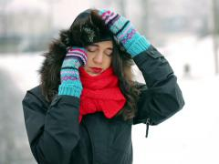 Upset woman talking on cellphone in the snowy park Stock Footage