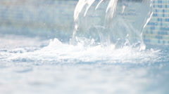 Water slowly running into swimming pool Stock Footage
