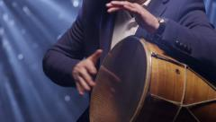 Man playing dhol drum. Musician plays drum. Stock Footage