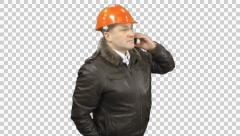 An industry businessman technical manager standing with a mobile phone, Alpha  Stock Footage